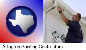 Arlington, Texas - a painting contractor brushing paint on an aluminum leader
