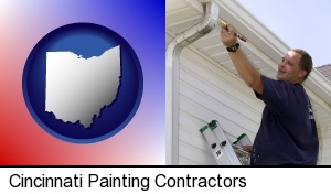 Cincinnati, Ohio - a painting contractor brushing paint on an aluminum leader
