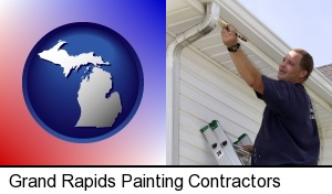 Grand Rapids, Michigan - a painting contractor brushing paint on an aluminum leader