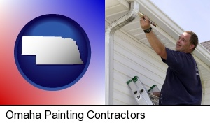 Omaha, Nebraska - a painting contractor brushing paint on an aluminum leader