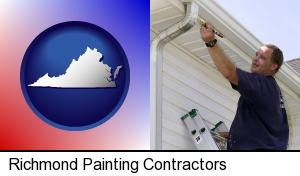 Richmond, Virginia - a painting contractor brushing paint on an aluminum leader