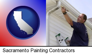 Sacramento, California - a painting contractor brushing paint on an aluminum leader