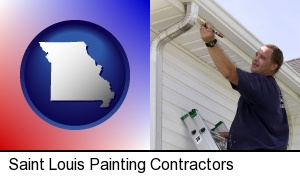 Saint Louis, Missouri - a painting contractor brushing paint on an aluminum leader