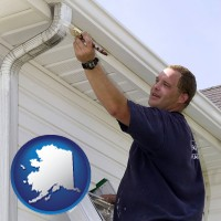 alaska map icon and a painting contractor brushing paint on an aluminum leader