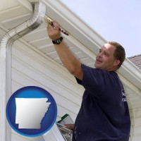 arkansas a painting contractor brushing paint on an aluminum leader