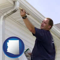 arizona a painting contractor brushing paint on an aluminum leader