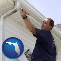 florida map icon and a painting contractor brushing paint on an aluminum leader