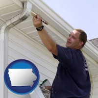 iowa map icon and a painting contractor brushing paint on an aluminum leader