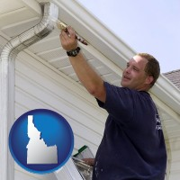 idaho map icon and a painting contractor brushing paint on an aluminum leader