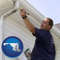 maryland a painting contractor brushing paint on an aluminum leader