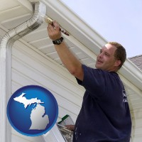 michigan a painting contractor brushing paint on an aluminum leader