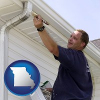 missouri a painting contractor brushing paint on an aluminum leader