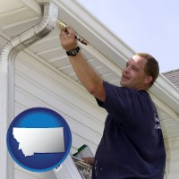 montana a painting contractor brushing paint on an aluminum leader