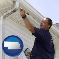 nebraska map icon and a painting contractor brushing paint on an aluminum leader