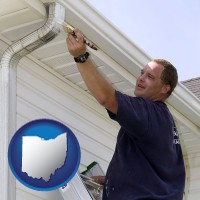 ohio map icon and a painting contractor brushing paint on an aluminum leader