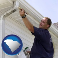 south-carolina map icon and a painting contractor brushing paint on an aluminum leader