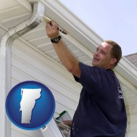 vermont a painting contractor brushing paint on an aluminum leader