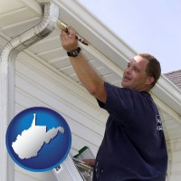 west-virginia a painting contractor brushing paint on an aluminum leader